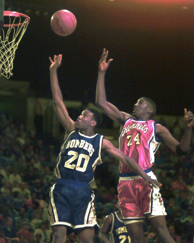 New Putnam City West basketball coach Lenny Bert was a coaches' All-State selection as a senior at Midwest City in 1995. Here he is in a game against Tulsa Washington, trying to battle the Hornets' Ryan Humphrey for a rebound in the 5A state title game in March 1995. Tulsa Washington won the game.