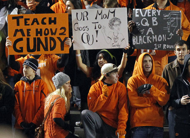 Cowboy fans show their support during the Bedlam college football game between the Oklahoma State University Cowboys (OSU) and the University of Oklahoma Sooners (OU) at Boone Pickens Stadium in Stillwater, Okla., Saturday, Dec. 3, 2011. Photo by Chris Landsberger, The Oklahoman