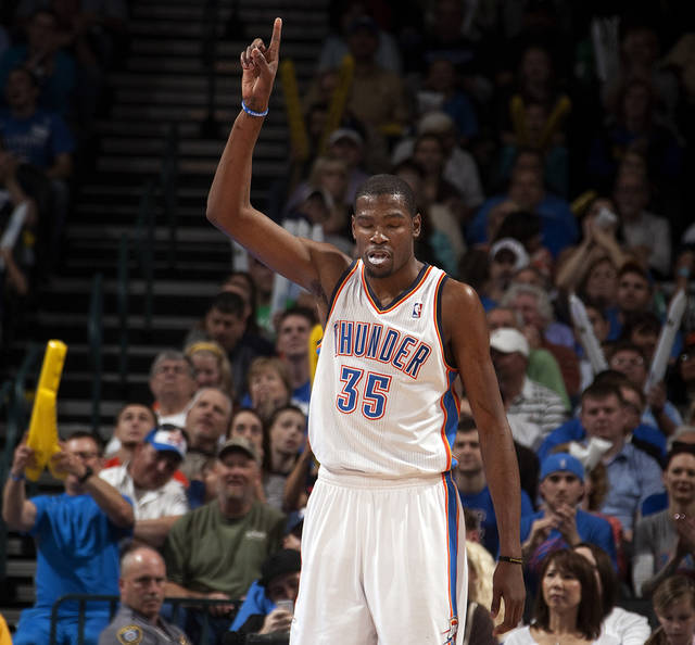 Oklahoma City's Kevin Durant (35) celebrates during the NBA basketball game between the Oklahoma City Thunder and the Toronto Raptors at Chesapeake Energy Arena in Oklahoma City, Sunday, April 8, 2012. Photo by Sarah Phipps, The Oklahoman.