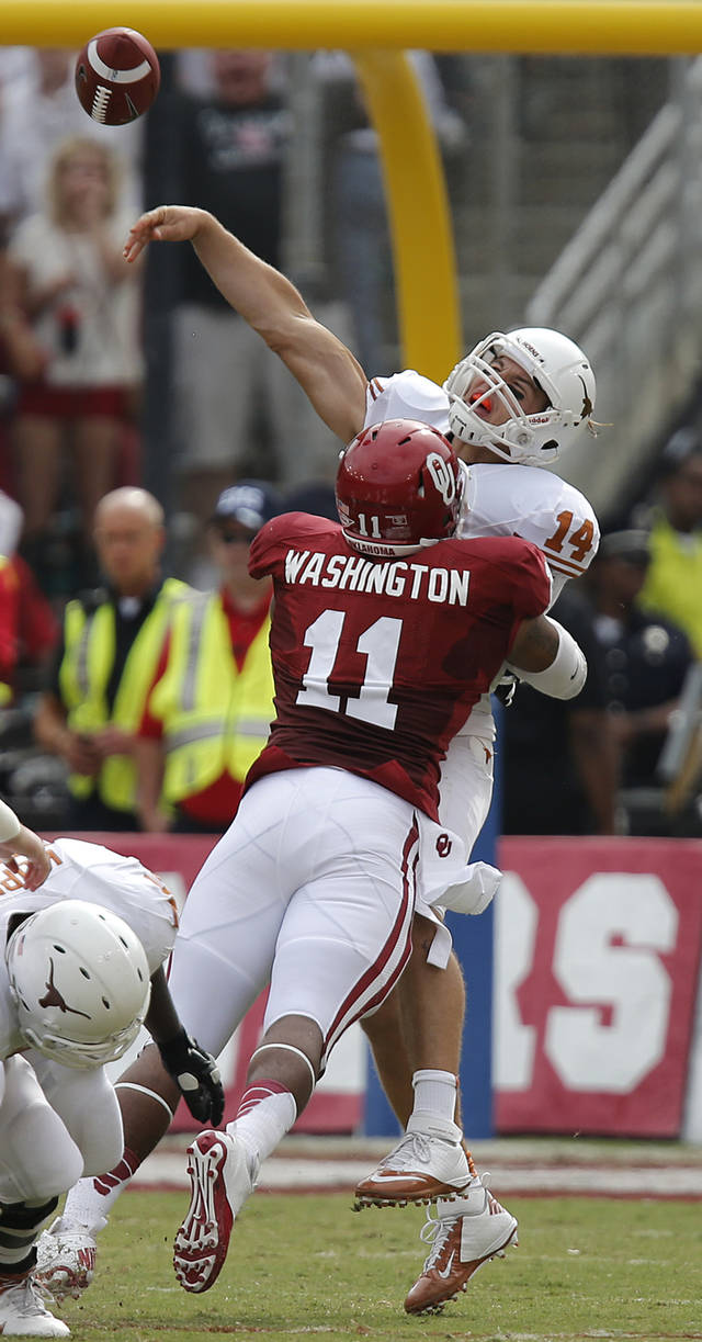 OU's R.J. Washington (11) hits UT's David Ash (14) during the Red River Rivalry college football game between the University of Oklahoma (OU) and the University of Texas (UT) at the Cotton Bowl in Dallas, Saturday, Oct. 13, 2012. Photo by Chris Landsberger, The Oklahoman