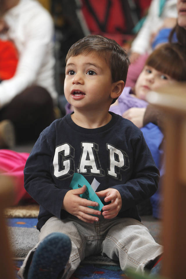 Armen Baghdayan, 2, listens as Sarah Fox, children's services assistant for the Norman Public Lobrary, leads family story time on Saturday, Jan. 21, 2012, in Norman, Okla.   Photo by Steve Sisney, The Oklahoman