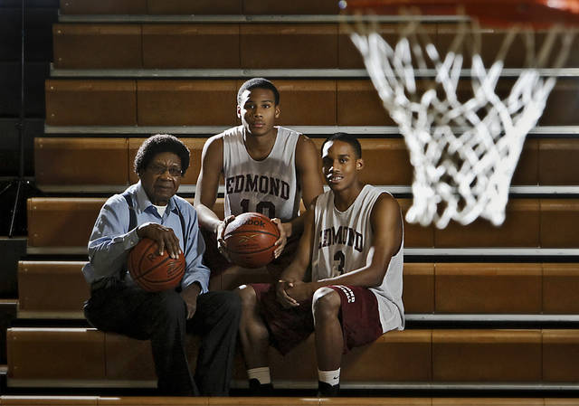 James A. Woodard poses with a photo with his grandson's Jordan, center, and James H. Woodard who play for Edmond Memorial High School on Friday, Nov. 18, 2011. in Edmond, Okla.  Photo by Chris Landsberger, The Oklahoman