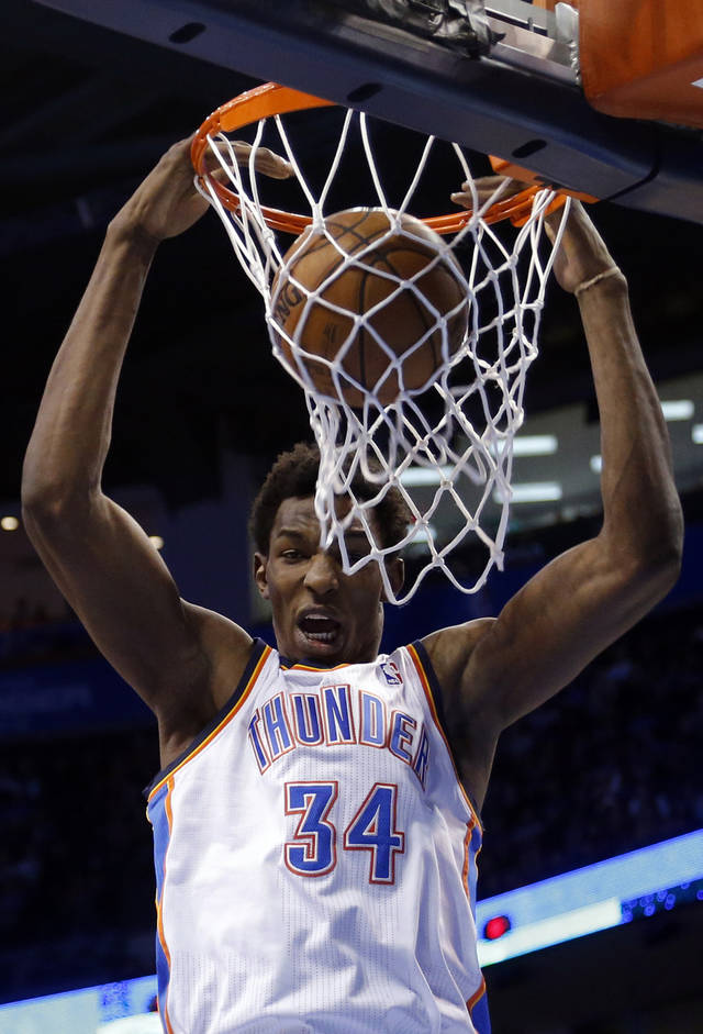 Oklahoma City's Hasheem Thabeet (34) dunks the ball during the NBA basketball game between the Oklahoma City Thunder and the Memphis Grizzlies at the Chesapeake Energy Arena in Oklahoma City,  Thursday, Jan. 31, 2013.Photo by Sarah Phipps, The Oklahoman