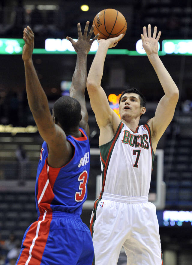 Detroit Pistons' Rodney Stuckey (3) defends as Milwaukee Bucks' Ersan Ilyasova (7) shoots the ball during the second half of an NBA basketball game on Saturday, Oct. 13, 2012, in Milwaukee. The Bucks defeated the Pistons 108-91. (AP Photo/Jim Prisching)