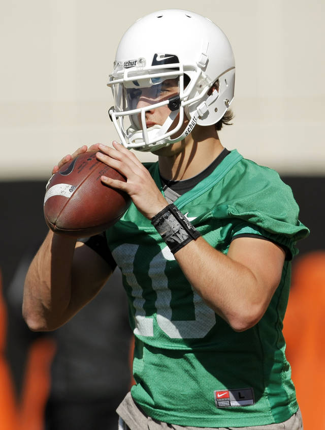 Clint Chelf (10) looks to pass during OSU spring football practice at Boone Pickens Stadium on the campus of Oklahoma State University in Stillwater, Okla., Monday, March 12, 2012. Photo by Nate Billings, The Oklahoman