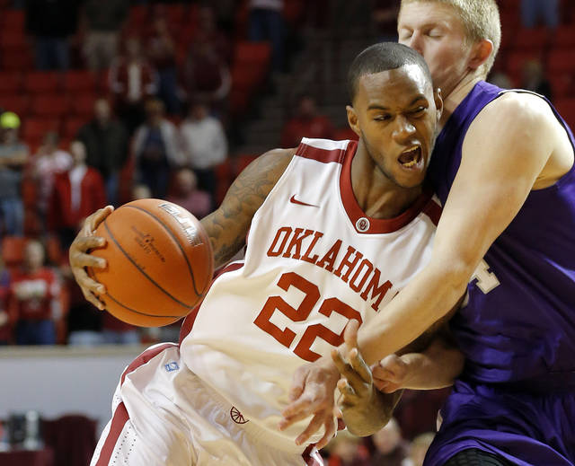 Oklahoma's Amath M'Baye (22) tries to get around Stephen F. Austin's Jacob Parker (34) during a college basketball game between the University of Oklahoma (OU) and Stephen F. Austin University at the Lloyd Noble Center in Norman, Okla., Tuesday, Dec. 18, 2012. Photo by Bryan Terry, The Oklahoman
