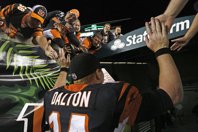 Cincinnati Bengals quarterback Andy Dalton leaves the field after the Bengals defeated the Pittsburgh Steelers 20-10 in an NFL football game, Monday, Sept. 16, 2013, in Cincinnati. (AP Photo/David Kohl)