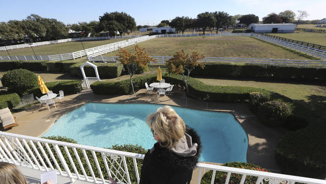 Shown in this photo made Tuesday, Nov. 13, 2012, is the backyard pool of the mansion at Southfork Ranch made famous by the Dallas TV  show in Parker, Texas. Tourists have been flocking to Southfork Ranch since the early years of the classic series, which ran from 1978 to 1991. And a new �Dallas� starting its second season on TNT on Monday and the recent death of the show's star, Larry Hagman, who legendarily played conniving Texas oilman J.R. Ewing, have also spurred fans to visit. (AP Photo/LM Otero)