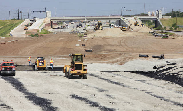 Update story on where construction stands at the I-40 Crosstown Expressway project, Friday,  June 17, 2011.   Construction  workers lay the rock for the road bead looking west from the Walker Bridge.     Photo by David McDaniel, The Oklahoman