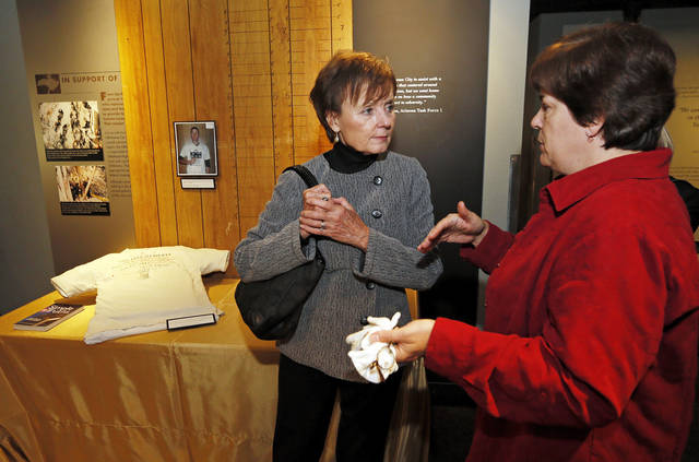 Collections manager Helen Stiefmiller, right, talks with Karen Luke, former chairman of the board of the Oklahoma City National Memorial Foundation, while touring parts of the Oklahoma City National Memorial & Museum that are to be updated and include artifacts not currently displayed. At left is the T-shirt Timothy McVeigh was wearing when he was arrested. Members of the original 350-member Memorial Task Force were shown planned changes to the museum to be completed over the next two years. Photo by Nate Billings, The Oklahoman <strong>NATE BILLINGS - NATE BILLINGS</strong>