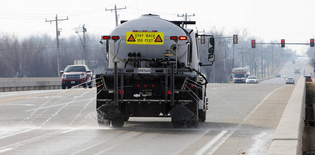 An Oklahoma City employee in a brine truck spraying a 23 percent brine solution on the Portland bridge over the Oklahoma River in  Oklahoma City Monday, Dec. 24, 2012.  Photo by Paul B. Southerland, The Oklahoman