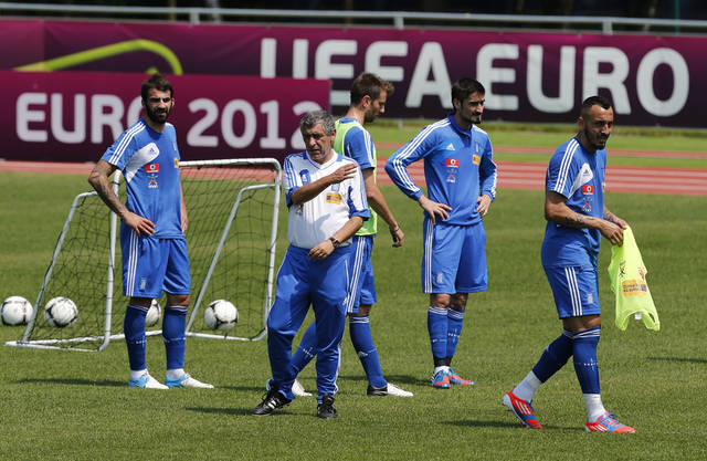 Greece's coach Fernando Santos gives directions to his players during a training session at the Euro 2012 soccer championship in Legionowo about 25 kilometers (15 miles) north of Warsaw, Poland on Monday, June 18, 2012. (AP Photo/Thanassis Stavrakis)