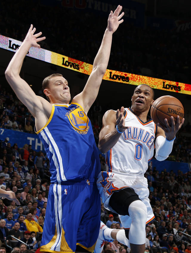 Oklahoma City's Russell Westbrook (0) goes past Golden State's Andris Biedrins (15) during an NBA basketball game between the Oklahoma City Thunder and the Golden State Warriors at Chesapeake Energy Arena in Oklahoma City, Wednesday, Feb. 6, 2013. Photo by Bryan Terry, The Oklahoman