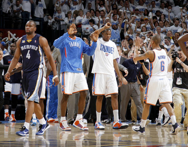 Oklahoma City's Serge Ibaka (9), Kevin Durant (35), and  Eric Maynor (6) celebrate as Sam Young (4) of Memphis walks off the court after game five of the Western Conference semifinals between the Memphis Grizzlies and the Oklahoma City Thunder in the NBA basketball playoffs at Oklahoma City Arena in Oklahoma City, Wednesday, May 11, 2011. Photo by Bryan Terry, The Oklahoman