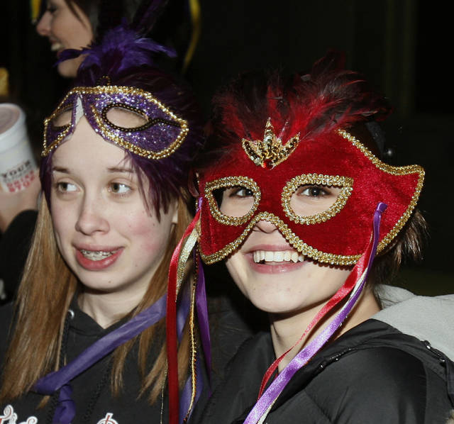Maggie McGuffee and Lauren Straily watch a Mardi Gras parade in downtown Norman, Oklahoma on Saturday, February 17, 2007.   Photo by Steve Sisney/The Oklahoman