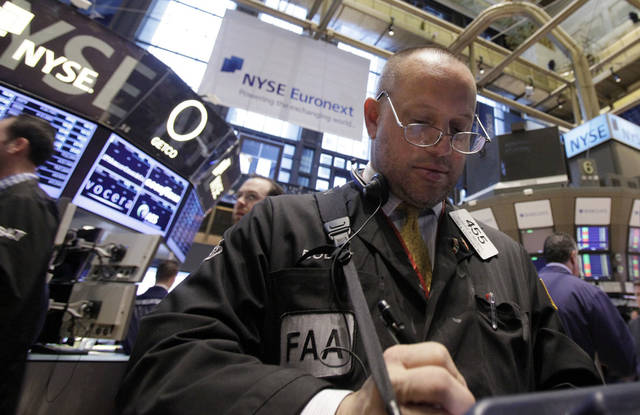 Trader Robert Arciero works April 16 on the floor of the New York Stock Exchange.  AP Photo