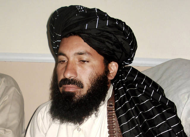 ALTERNATE CROP - In this April, 20, 2007 file photo, Pakistani militant commander Maulvi Nazir meets his associates in South Waziristan, Pakistan near the Afghani border. Five Pakistani security officials said the commander, Nazir, was reportedly among nine people killed in a missile strike on a house in the village of Angoor Adda in the South Waziristan tribal region early Thursday. The officials spoke on condition of anonymity because they were not authorized to brief the media. (AP Photo/Ishtiaq Mahsud)