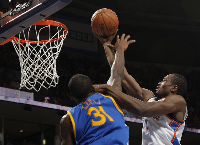 Oklahoma City 's Serge Ibaka (9) takes a shot over Golden State's Festus Ezeli (31) during an NBA basketball game between the Oklahoma City Thunder and the Golden State Warriors at Chesapeake Energy Arena in Oklahoma City, Sunday, Nov. 18, 2012.  Photo by Garett Fisbeck, The Oklahoman