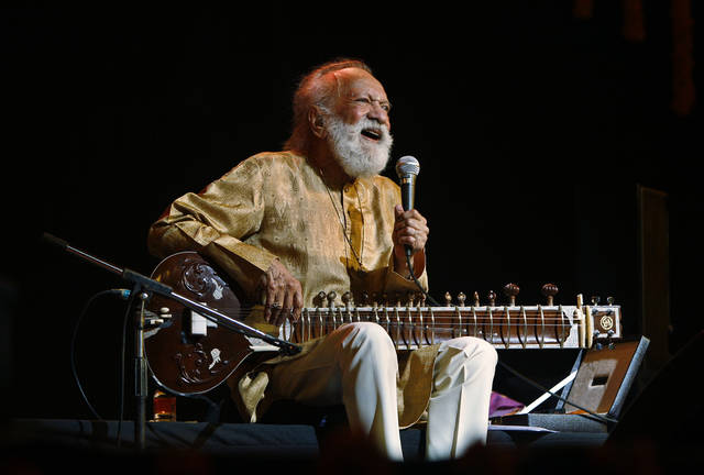 FILE - In this Feb. 7, 2012 file photo, Indian musician Ravi Shankar laughs as he speaks during a concert in Bangalore, India. Shankar, the sitar virtuoso who became a hippie musical icon of the 1960s after hobnobbing with the Beatles and who introduced traditional Indian ragas to Western audiences over an eight-decade career, has died. He was 92.  (AP Photo/Aijaz Rahi, File)