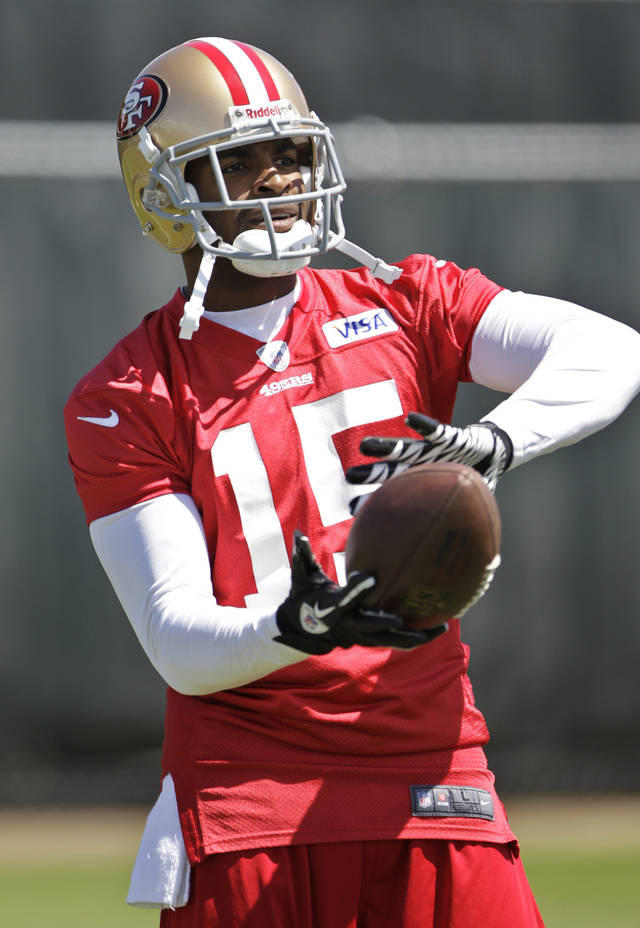 San Francisco 49ers wide receiver Michael Crabtree catches a pass during NFL football practice at the team's training facility in Santa Clara, Calif., Tuesday, June 5, 2012. (AP Photo/Paul Sakuma)