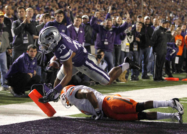 Kansas State's John Hubert (33) scores a touchdown past Oklahoma State's Shamiel Gary (7) during the college football game between the Oklahoma State University Cowboys (OSU) and the Kansas State University Wildcats (KSU) at Bill Snyder Family Football Stadium on Saturday, Nov. 1, 2012, in Manhattan, Kan. Photo by Chris Landsberger, The Oklahoman