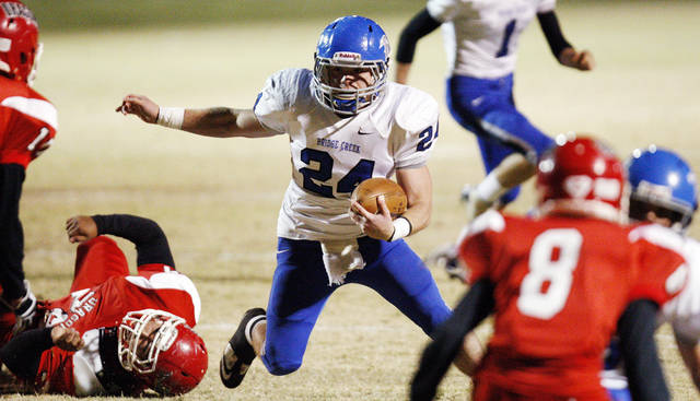 Chris Golden (24) of Bridge Creek leaves behind a Purcell defender during a high school football playoff game between Purcell and Bridge Creek at Conger Field in Purcell, Okla.,Friday, Nov. 11, 2011. Photo by Nate Billings, The Oklahoman