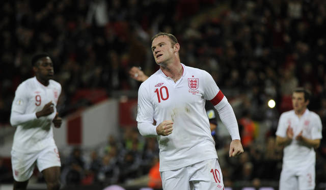 England's Wayne Rooney celebrates his penalty goal during their World Cup Group H qualifying soccer match agains San Marino at Wembley Stadium in London, Friday Oct. 12, 2012. (AP Photo/Tom Hevezi)