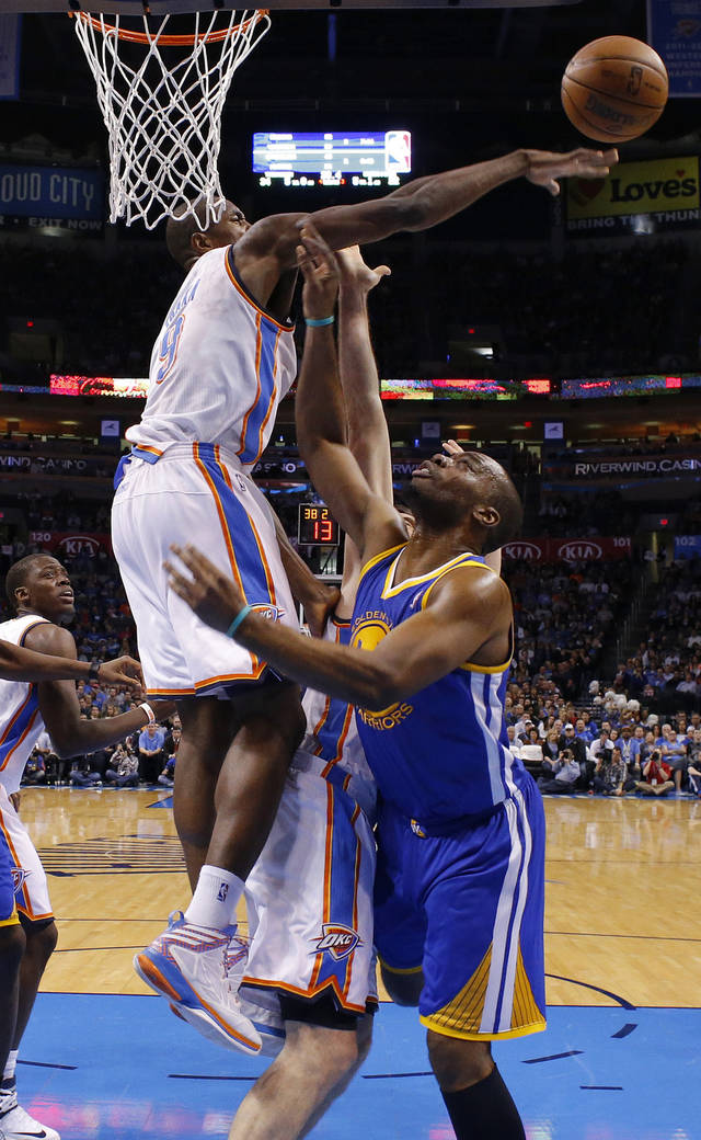 Oklahoma City's Serge Ibaka (9) blocks the shot of Golden State's Carl Landry (7) during an NBA basketball game between the Oklahoma City Thunder and the Golden State Warriors at Chesapeake Energy Arena in Oklahoma City, Wednesday, Feb. 6, 2013. Photo by Bryan Terry, The Oklahoman