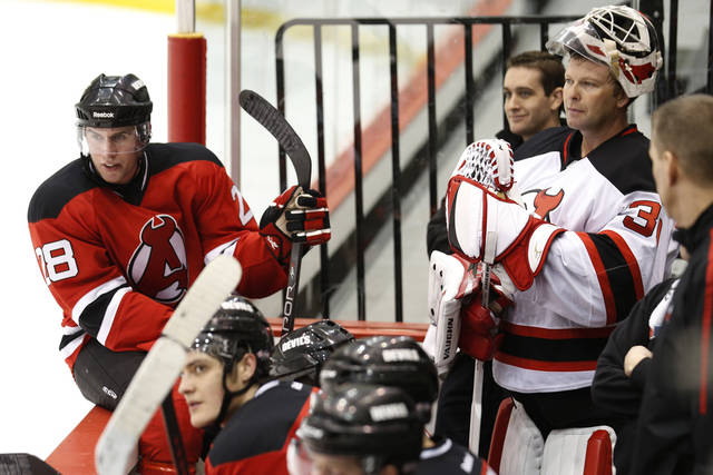 New Jersey Devils goalie Martin Brodeur, right, stands at the bench with members of the Albany Devils, the team's AHL farm team, during a scrimmage on Wednesday, Jan. 16, 2013, in Newark, N.J. (AP Photo/Julio Cortez)