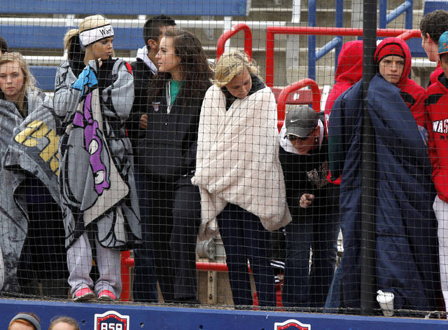Washington fans bundle up against the cold during the class 3A Girl's State Softball playoffs at the ASA Hall of Fame Stadium in Oklahoma City, OK, Friday, October 5, 2012,  By Paul Hellstern, The Oklahoman