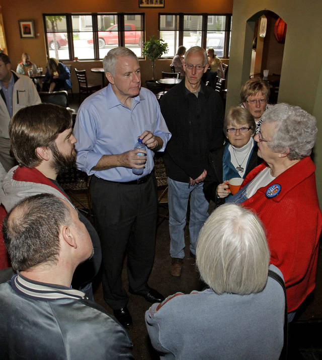 Milwaukee Mayor Tom Barrett, upper left, a Democratic candidate in the recall election targeting Republican Gov. Scott Walker, stops to talk to voters Monday, May 7, 2012, at Z-Spot Espresso & Coffee in Sheboygan, Wis. (AP Photo/The Sheboygan Press, Bruce Halmo)