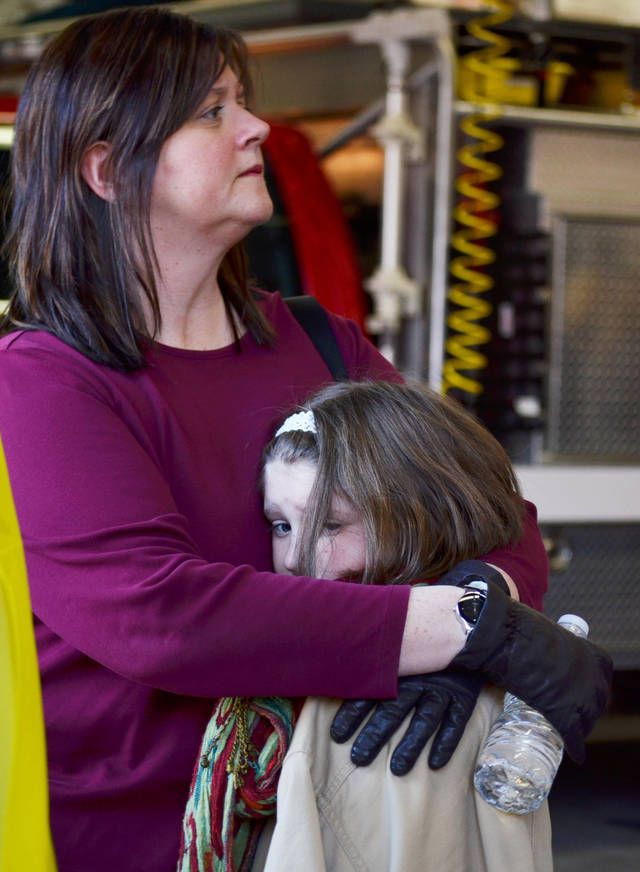 A mother hugs her daughter following a shooting at the Sandy Hook Elementary School in Newtown, Conn., about 60 miles (96 kilometers) northeast of New York City, Friday, Dec. 14, 2012. An official with knowledge of Friday's shooting said 27 people were dead, including 18 children. It was the worst school shooting in the country's history. (AP Photo/The New Haven Register, Melanie Stengel)   ORG XMIT: CTNHR104