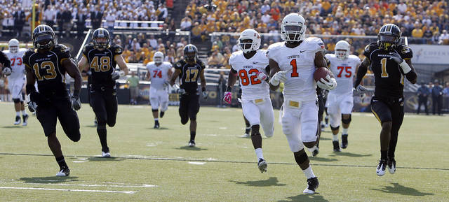 Oklahoma State's Joseph Randle (1) runs for a touchdown as the Missouri defense chases him during a college football game between the Oklahoma State University Cowboys (OSU) and the University of Missouri Tigers (Mizzou) at Faurot Field in Columbia, Mo., Saturday, Oct. 22, 2011. Photo by Sarah Phipps, The Oklahoman