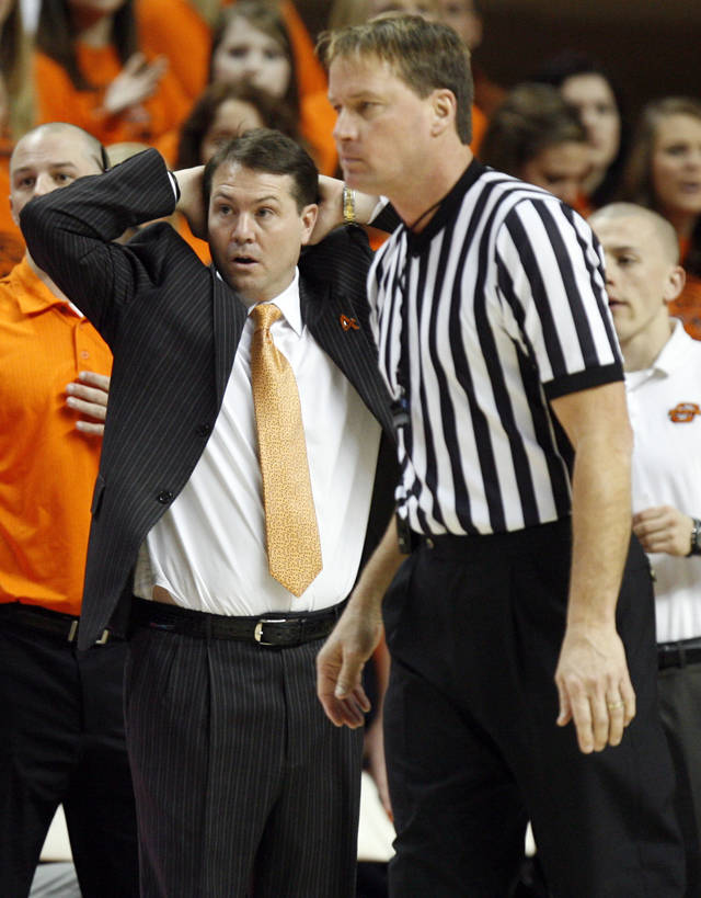 OSU head coach Travis Ford reacts to a foul called against the Cowboys in the second half of a men's college basketball game between the Oklahoma State University Cowboys and Texas A&M University Aggies at Gallagher-Iba Arena in Stillwater, Okla., Saturday, Feb. 25, 2012. OSU won, 60-42. Photo by Nate Billings, The Oklahoman