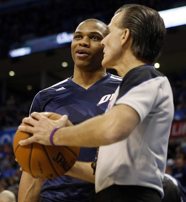 Oklahoma City's Russell Westbrook (0) talks with referee Ken Mauer (41) during an NBA basketball game between the Oklahoma City Thunder and the Dallas Mavericks at Chesapeake Energy Arena in Oklahoma City, Sunday, March 16, 2014. Dallas won, 109-86. Photo by Nate Billings, The Oklahoman