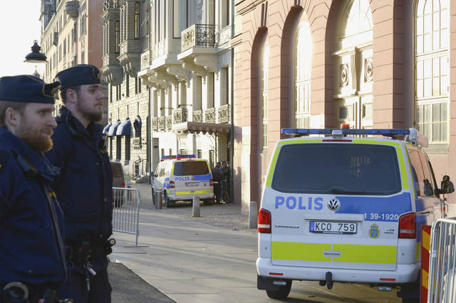"This photo shows police outside the Swedish Prime Minister Fredrik Reinfeldt´s residence Sagerska Palace in Stockholm, Sweden Friday Nov. 9, 2012. A security guard at the Swedish prime minister's residence was killed Friday in what appeared to be a self-inflicted shooting, police and Swedish media said. The prime minister was not in the building. ""I can say nothing happened to the prime minister. He was not harmed,"" Stockholm police spokesman Lars Bystrom told The Associated Press. ""And it wasn't one of his bodyguards but some security guard. We do not suspect any crime."" (AP Photo/ Bertil Enevag Ericson) SWEDEN OUT"