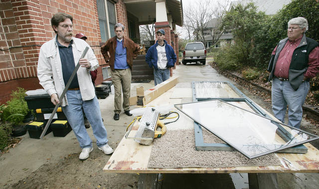 Bob Yapp (left), a national window repair expert, gives hands-on instructions on how to repair windows in historic houses Sat. Nov.21, 2009. Photo by Jaconna Aguirre, The Oklahoman. ORG XMIT: KOD <strong>Jaconna Aguirre - THE OKLAHOMAN</strong>