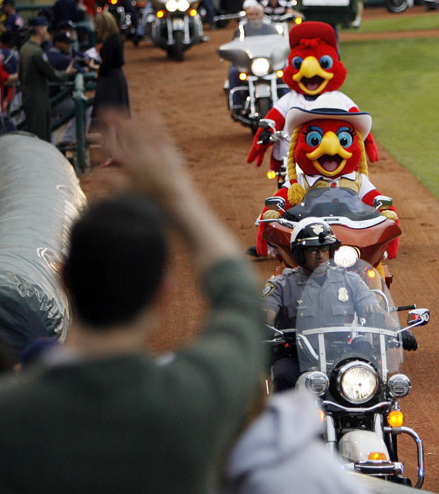 Oklahoma City mascots Ruby, front, and Cooper ride motorcycles around the field before the 2012 opening day baseball game between the Oklahoma City RedHawks and the Memphis Redbirds at the Chickasaw Bricktown Ballpark in Oklahoma City, Thursday, April 5, 2012. Photo by Nate Billings, The Oklahoman