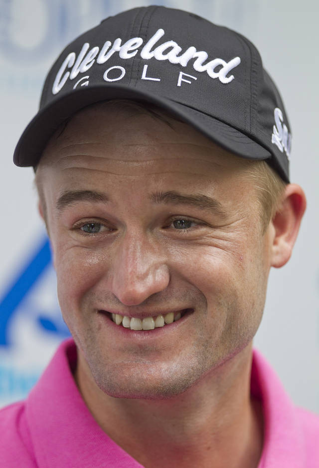 Russell Knox, of Scotland,  smiles as he talks with media after his round at the Boise Open golf tournament in Boise, Id., Friday, July 26, 2013. Knox shot a 12-under 59 for the day.  (AP Photo/The Idaho Statesman, Kyle Green) MANDATORY CREDIT. LOCAL TV OUT
