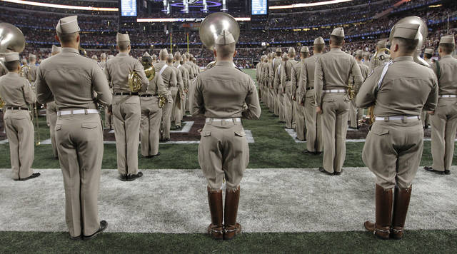 Members of the Texas A&M band prepare to take the field during the college football Cotton Bowl game between the University of Oklahoma Sooners (OU) and Texas A&M University Aggies (TXAM) at Cowboy's Stadium on Friday Jan. 4, 2013, in Arlington, Tx. Photo by Chris Landsberger, The Oklahoman