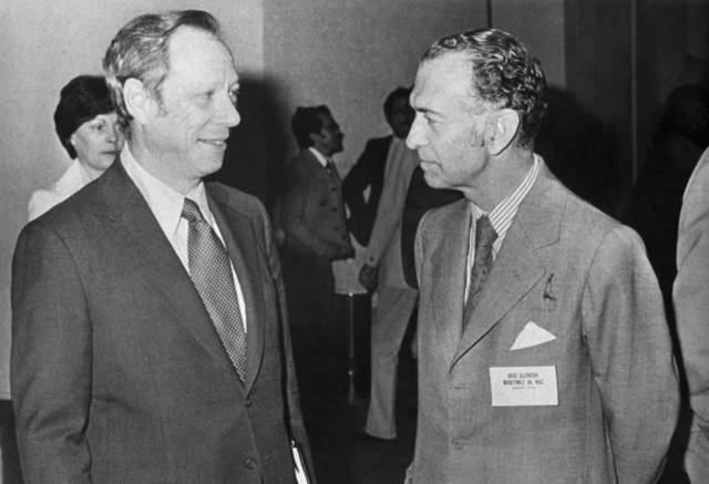 FILE - In this May 25, 1978 file photo, Argentina's Economy Minister Dr. Jose Alfredo Martinez de Hoz, right, talks with U.S. Treasury Secretary W. Michael  Blumenthal at the conclusion of the International Monetary conference in Mexico City. According to local media, Martinez de Hoz, who was the economy minister during Argentina's last military dictatorship, died Saturday, March 16, 2013. He was 87 and was under house arrest at the time of his death. (AP Photo, File)