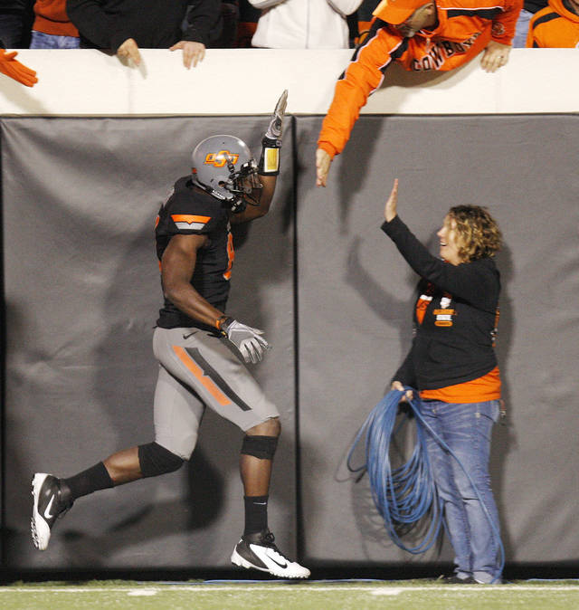 OSU's Justin Blackmon (81) runs down the sideline celebrating after a touchdown catch in the fourth quarter during a college football game between the Oklahoma State University Cowboys (OSU) and the Kansas State University Wildcats (KSU) at Boone Pickens Stadium in Stillwater, Okla., Saturday, Nov. 5, 2011. OSU won, 52-45. Photo by Nate Billings, The Oklahoman