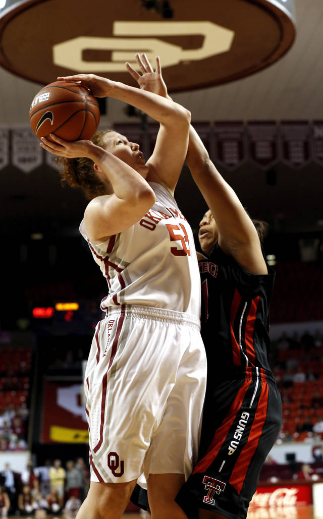Oklahoma Sooner's Joanna McFarland (53) shoots guarded by Tech's Kelsi Baker (41) as the University of Oklahoma Sooners (OU) play the Texas Tech Lady Red Raiders in NCAA, women's college basketball at The Lloyd Noble Center on Saturday, Jan. 12, 2013 in Norman, Okla. Photo by Steve Sisney, The Oklahoman