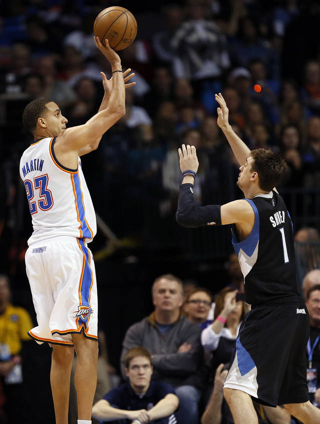 Oklahoma City's Kevin Martin (23) shoots against Minnesota's Alexey Shved (1) during an NBA basketball game between the Oklahoma City Thunder and Minnesota Timberwolves at Chesapeake Energy Arena in Oklahoma City, Friday, Feb. 22, 2013. Oklahoma City won, 127-111. Photo by Nate Billings, The Oklahoman