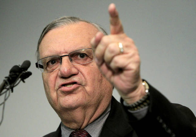 A defiant Maricopa County Sheriff Joe Arpaio speaks to the media before holding a ceremony where 92 of his immigration jail officers, who lost their federal power to check whether inmates are in the county illegally, turn in their credentials after federal officials pulled the Sheriff's office immigration enforcement powers Wednesday, Dec. 21, 2011, in Phoenix. The U.S. Department of Homeland Security stripped Sheriff Joe Arpaio's jail officers of their federal powers after federal authorities accused the sheriff's office last week of a wide range of civil rights violations. (AP Photo/Ross D. Franklin)