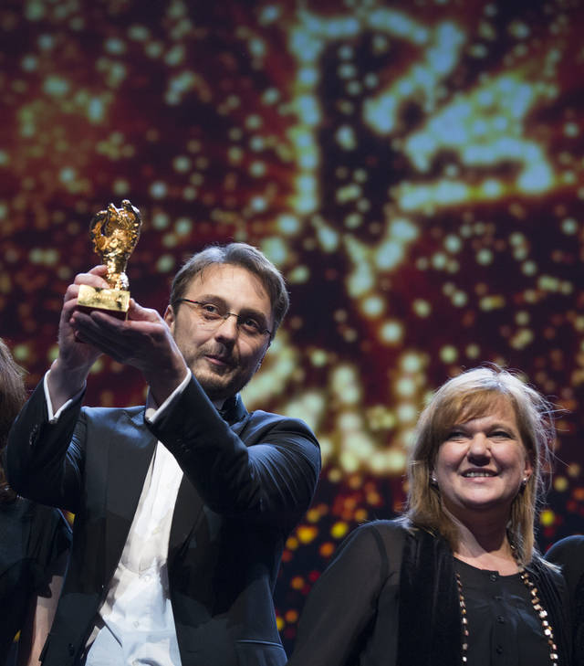 Director Calin Peter Netzer holds the Golden Bear for his film Child&#039;s Pose alongside producer Ada Solomon at the closing ceremony at the 63rd edition of the Berlinale, International Film Festival in Berlin, Saturday, Feb. 16, 2013. (AP Photo/Gero Breloer)