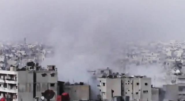 This image made from amateur video released by the Shaam News Network and accessed Sunday, June 17, 2012, purports to show smoke rising from buildings in Homs province, Syria. Activists say Syrian troops have intensified their shelling of rebel-held neighborhoods in the central city of Homs as living conditions there deteriorate further. (AP Photo/Shaam News Network via AP video) TV OUT, THE ASSOCIATED PRESS CANNOT INDEPENDENTLY VERIFY THE CONTENT, DATE, LOCATION OR AUTHENTICITY OF THIS MATERIAL