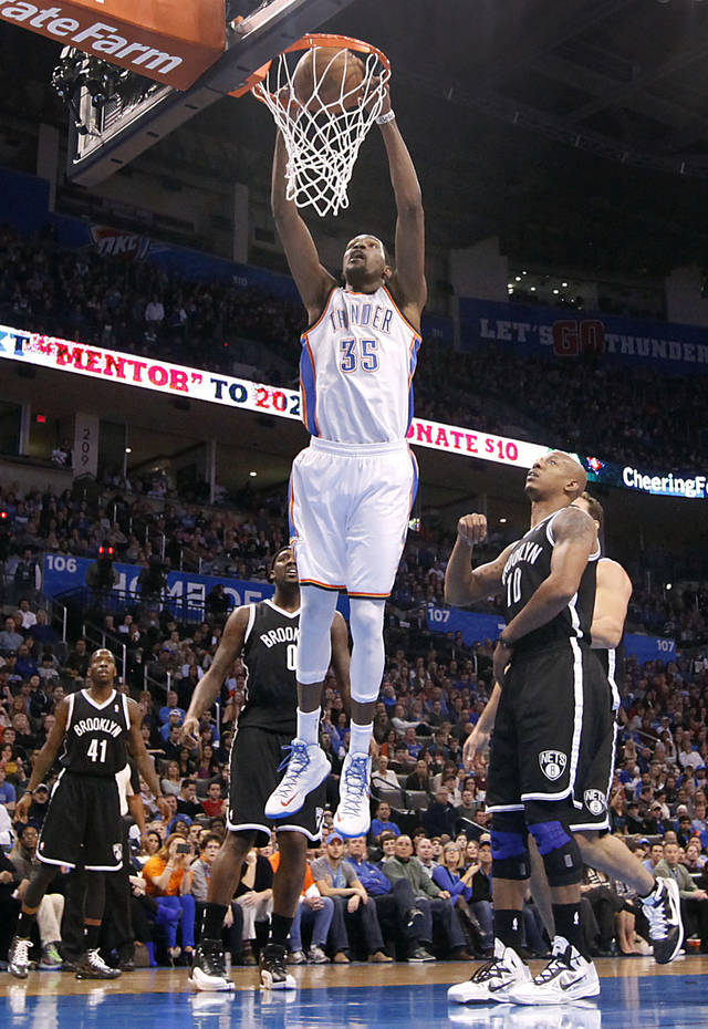 Oklahoma City's Kevin Durant (35) dunks the ball over Brooklyn Nets' Keith Bogans (10) during the NBA basketball game between the Oklahoma City Thunder and the Brooklyn Nets at the Chesapeake Energy Arena on Wednesday, Jan. 2, 2013, in Oklahoma City, Okla. Photo by Chris Landsberger, The Oklahoman
