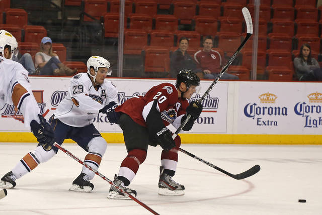 Chris VandeVelde of the Oklahoma City Barons chases Bryan Lerg of the Lake Erie Monsters during AHL hockey game at the Cox Convention Center in Oklahoma City, Tuesday, October 23, 2012. Photo by Bryan Terry, The Oklahoman