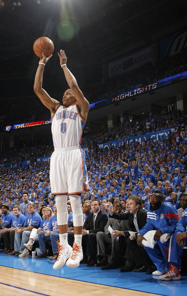 Oklahoma City's Russell Westbrook (0) shoots a three pointer during game one of the first round in the NBA playoffs between the Oklahoma City Thunder and the Dallas Mavericks at Chesapeake Energy Arena in Oklahoma City, Saturday, April 28, 2012. Photo by Sarah Phipps, The Oklahoman